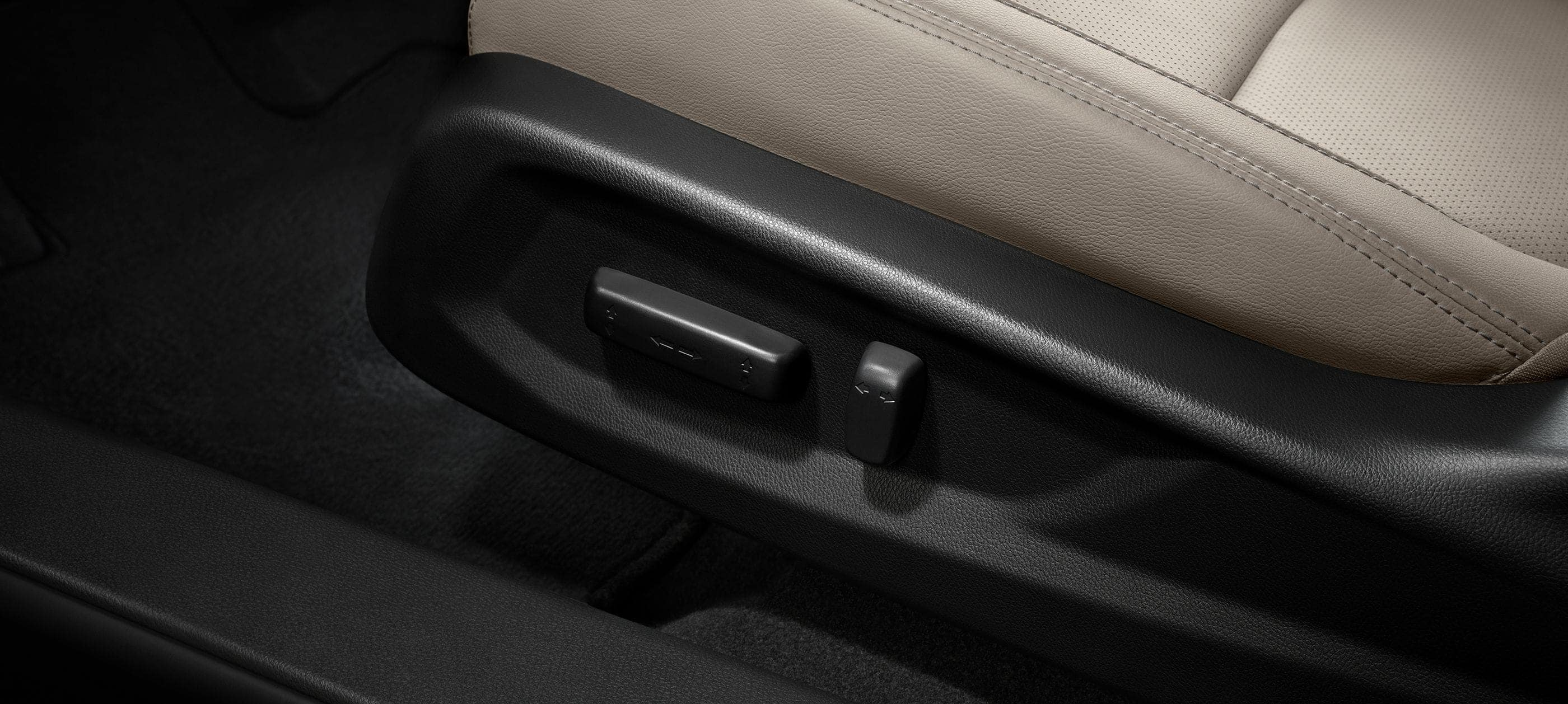 Detail of 8-way power-adjustable driver seat controls.