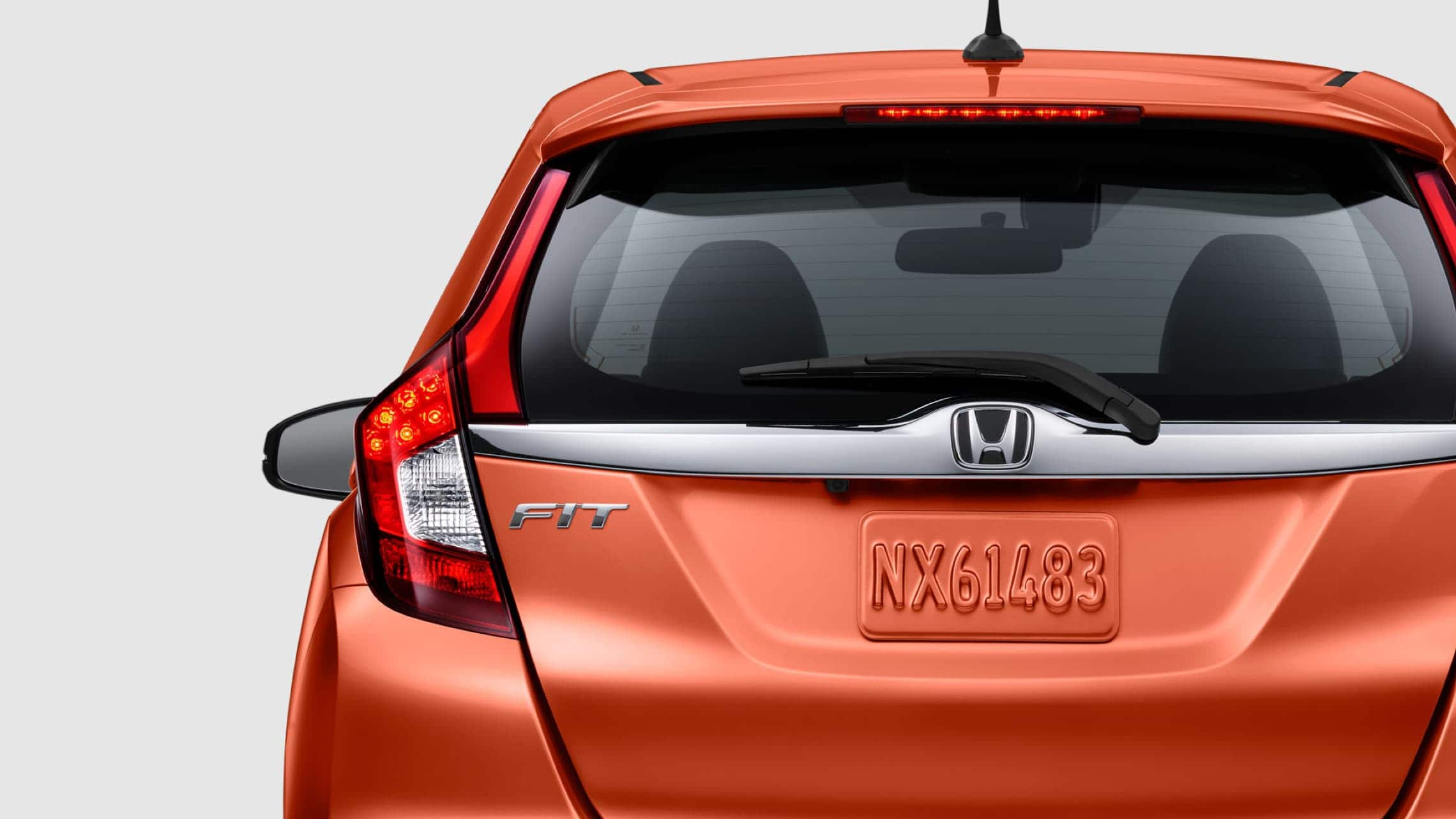 Exterior rear view of LED brake lights on 2019 Honda Fit EX-L in Orange Fury.