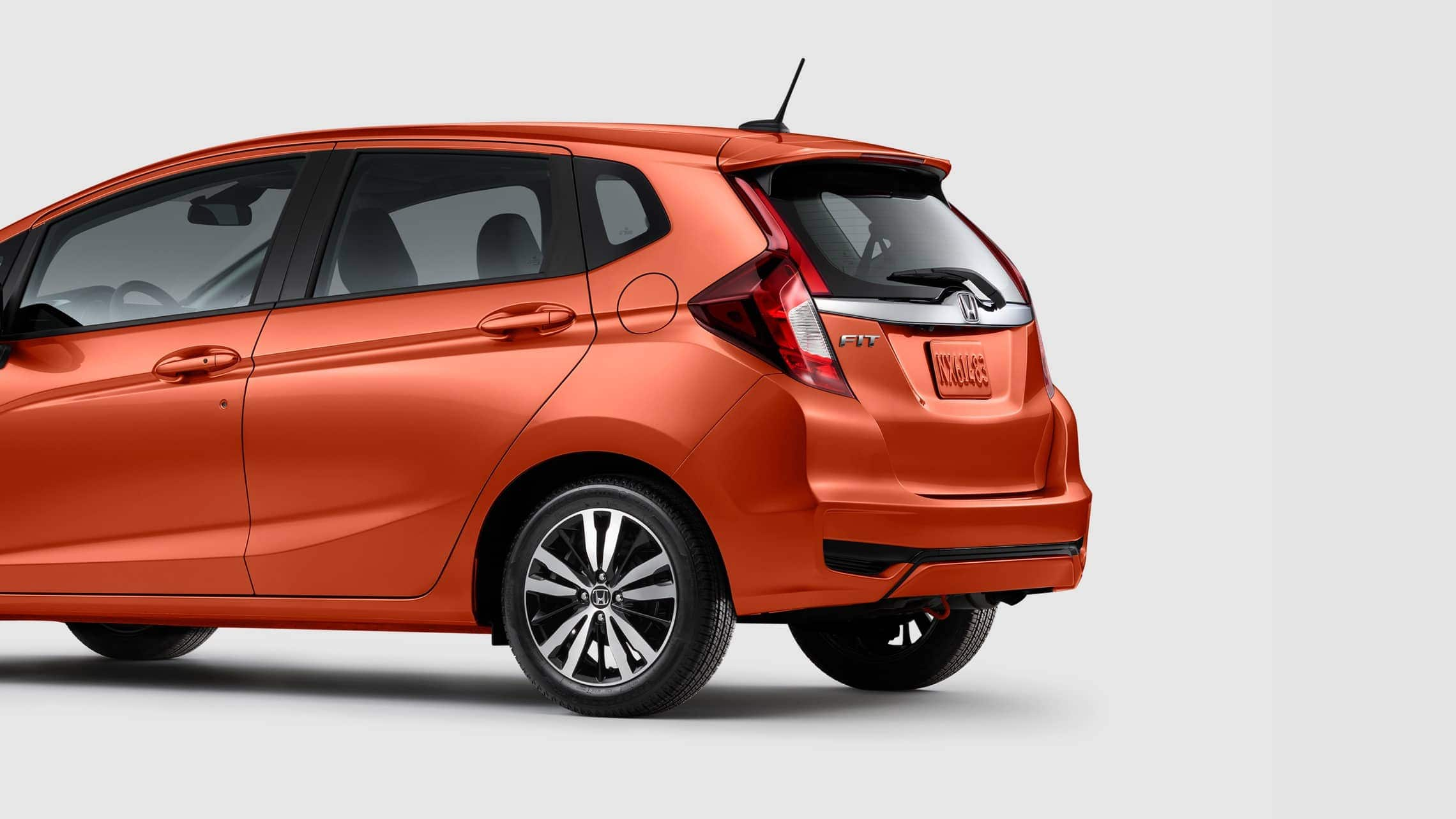 Rear 7/8 driver view of 2019 Honda Fit EX-L in Orange Fury.