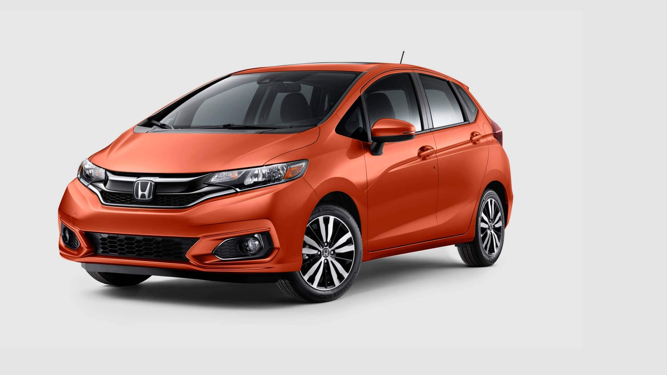 Front 3/4 driver side view of 2019 Honda Fit EX-L in Orange Fury.