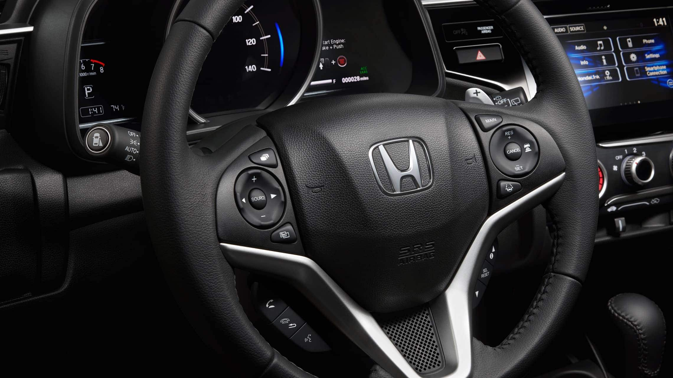 Steering wheel-mounted control detail on 2019 Honda Fit EX-L.