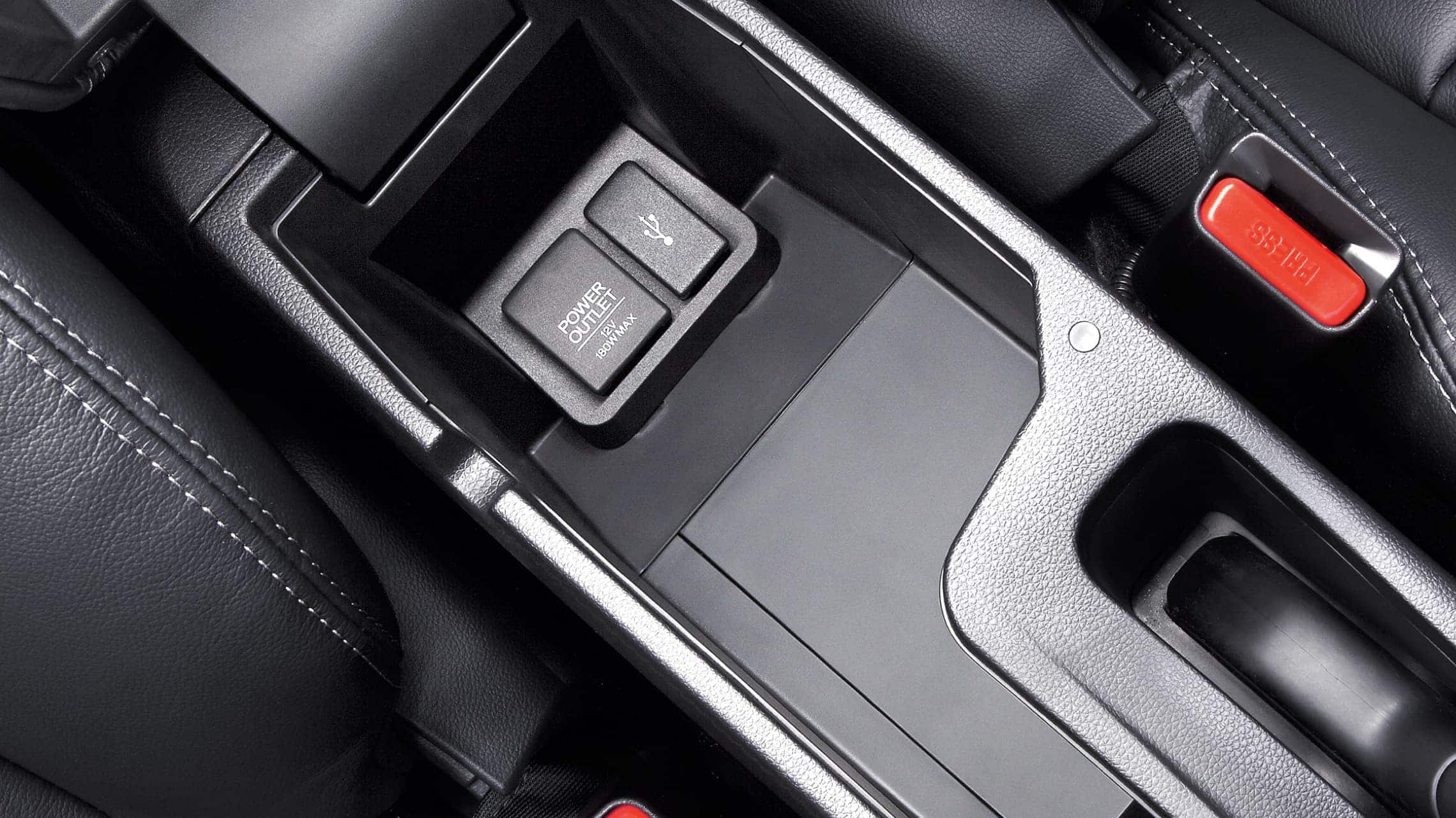 USB port detail in open center console of 2019 Honda Fit EX-L with Black Leather.
