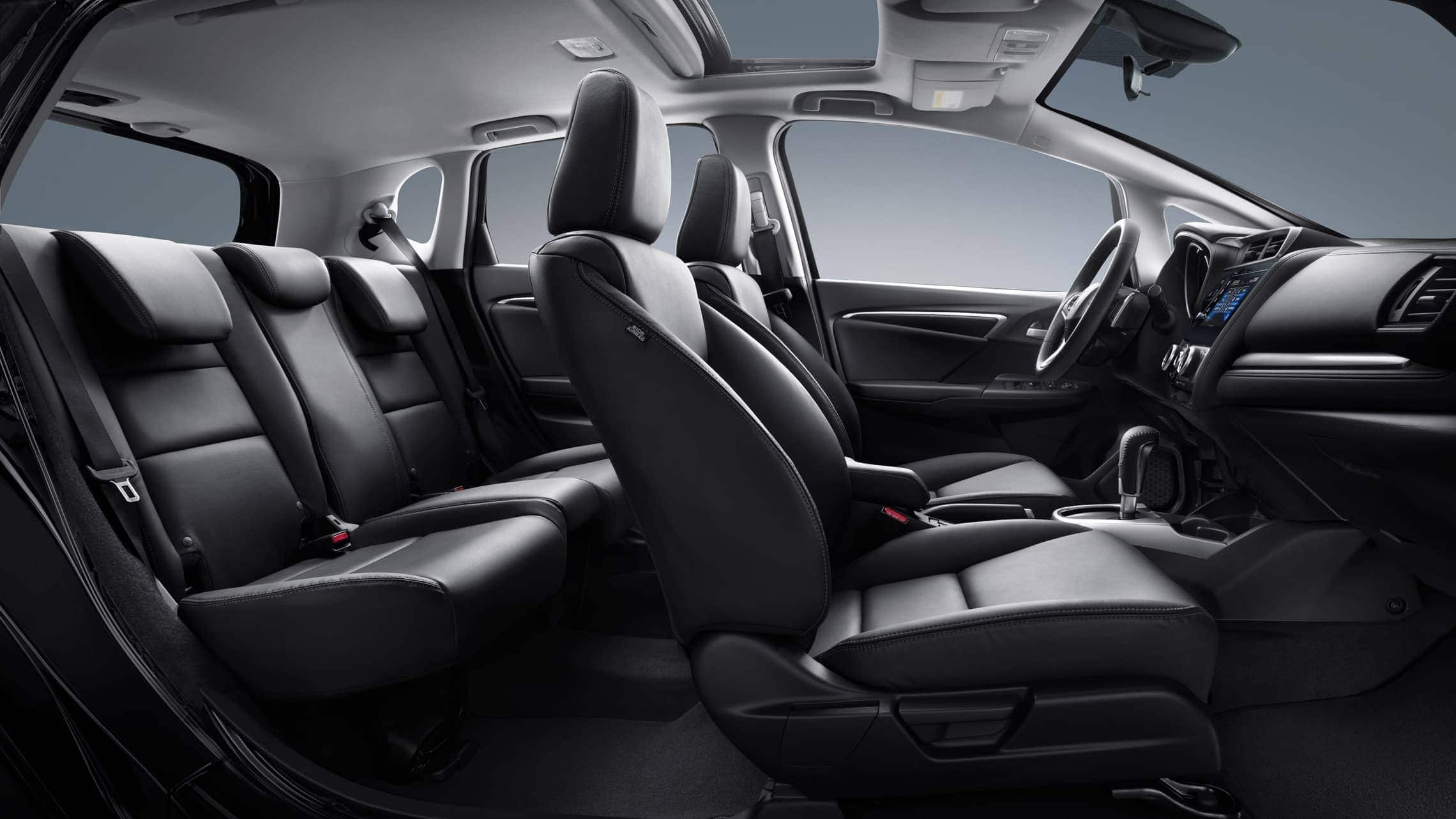 Interior passenger side profile view of 2019 Honda Fit EX-L with Black Leather.