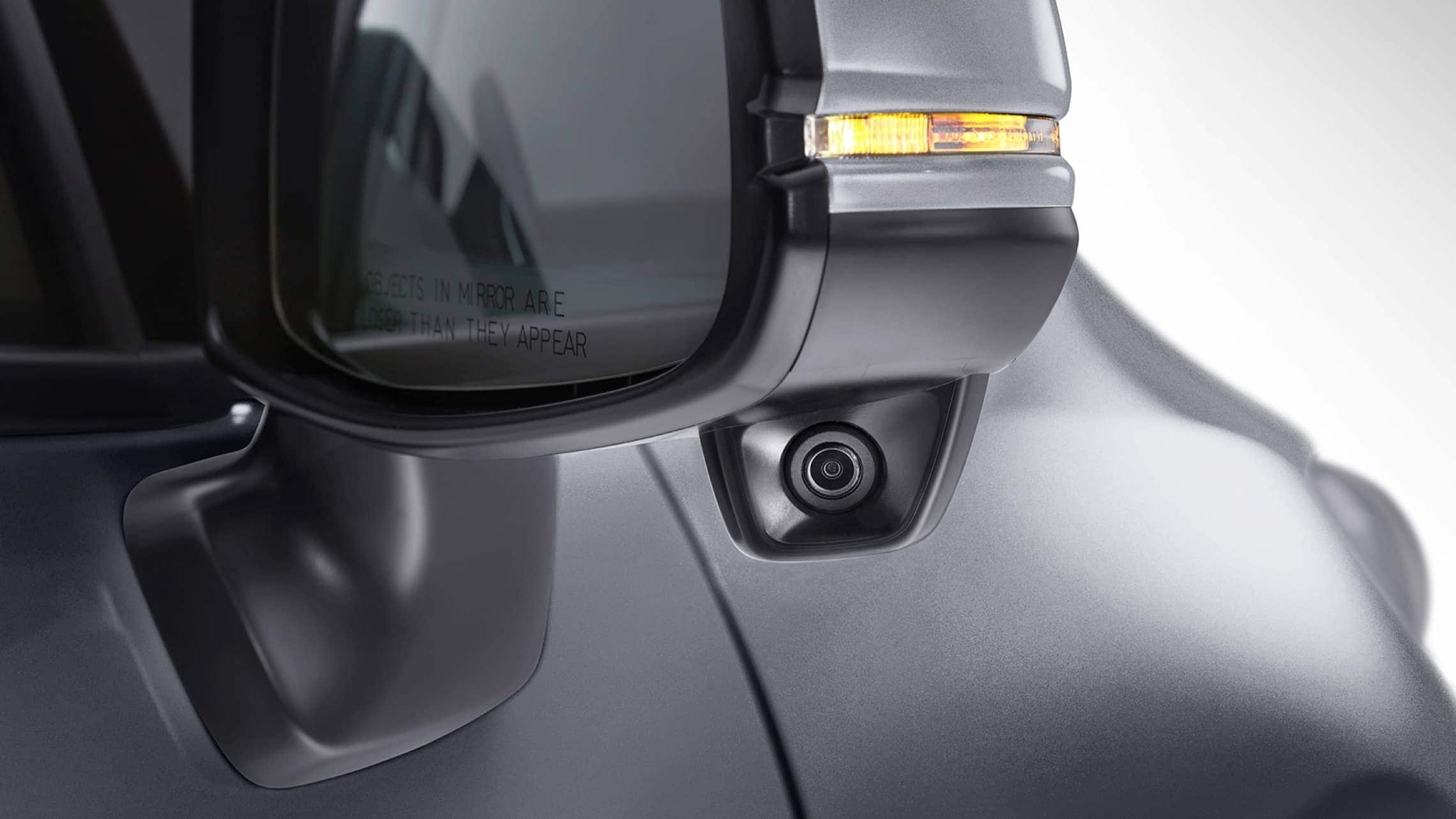 Exterior close up view of Honda LaneWatch™ feature on passenger side mirror on 2019 Honda Fit EX-L.