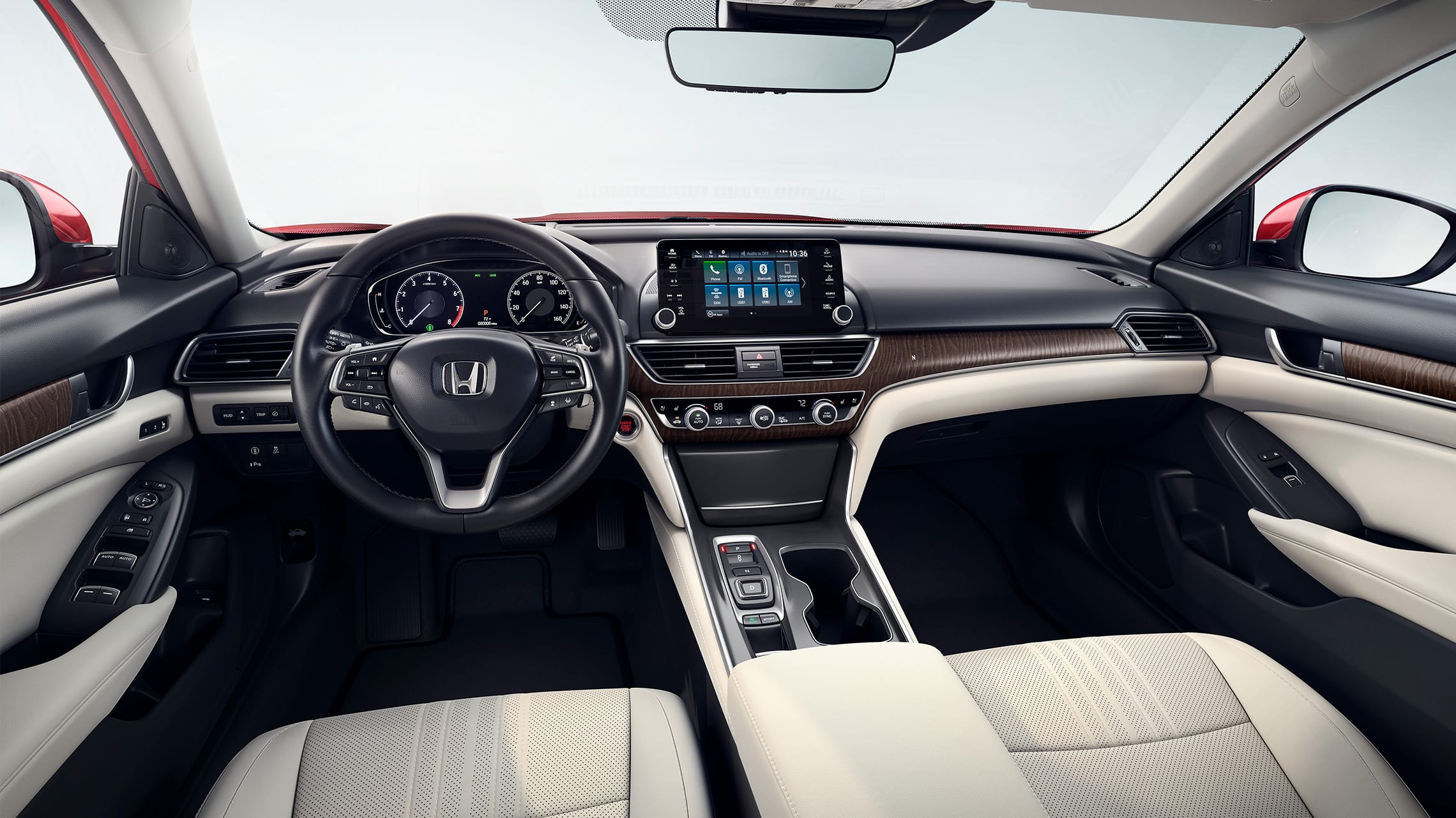 Interior view of front seats and dashboard in the 2020 Honda Accord Touring 2.0T with Ivory Leather.