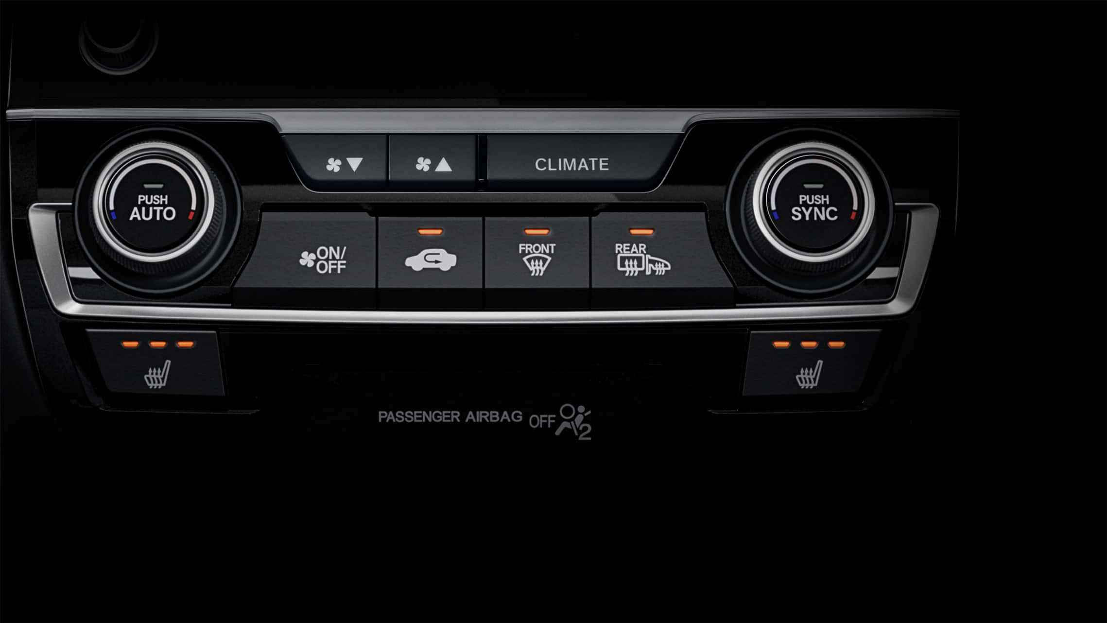 Detail of heated seat controls in the 2021 Honda Civic Sport Touring Hatchback.
