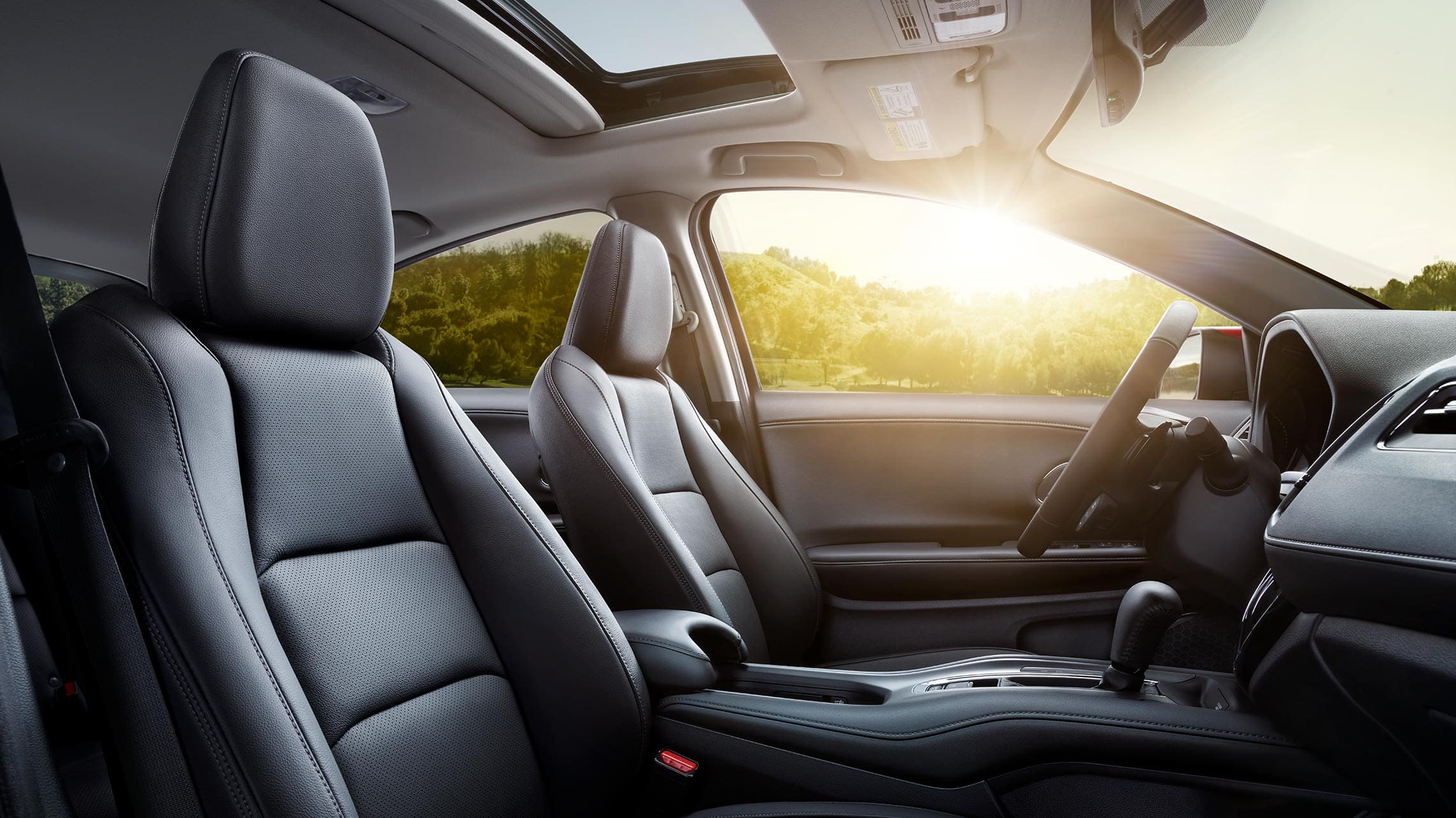 Interior passenger-side view of the 2020 Honda HR-V Touring seats in Black Leather.