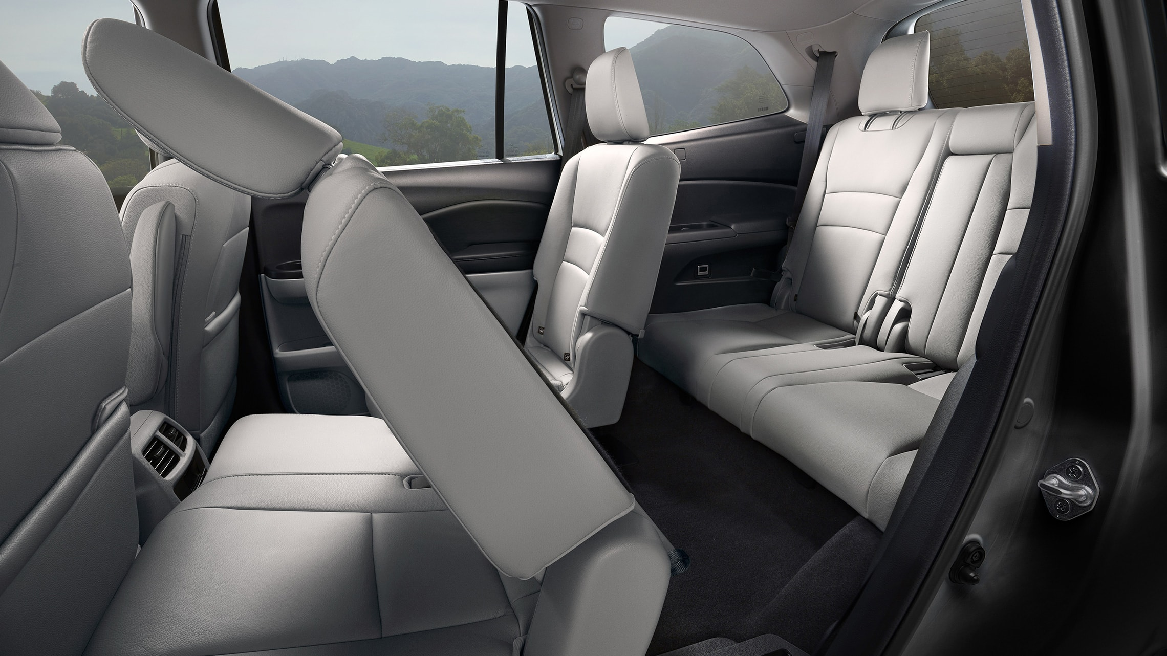 2nd-row captain's chair detail shown folded in 2020 Honda Pilot Elite with Gray Leather interior.