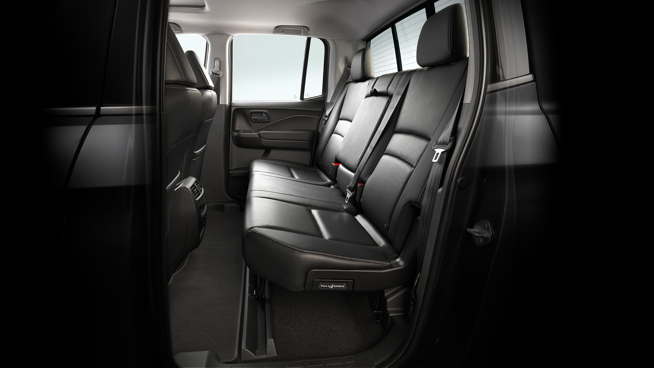 Interior view of the 60/40 split rear seats folded up, storing a bike in the 2020 Honda Ridgeline RTL-E with Gray Leather.