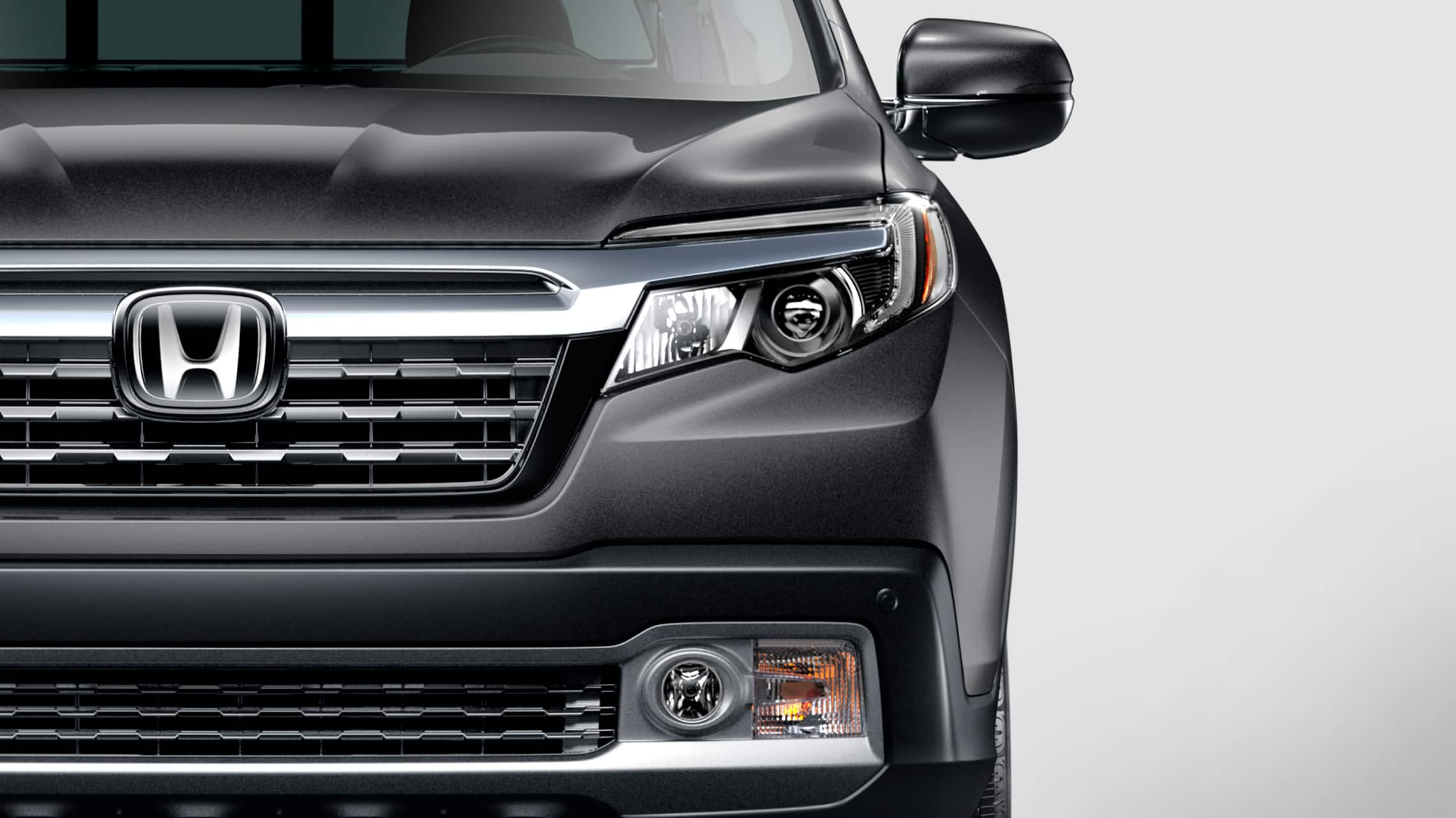 LED headlights detail on the 2020 Honda Ridgeline RTL-E in modern Steel Metallic.