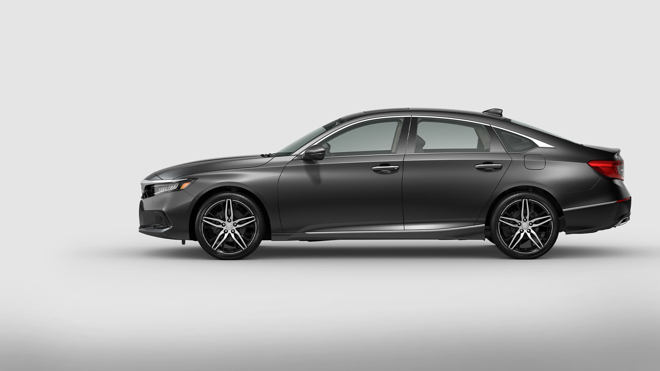 Driver-side profile view of the 2021 Honda Accord Touring 2.0T in Modern Steel Metallic.