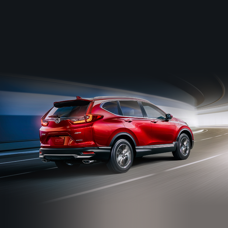 Rear passenger-side view of 2021 Honda CR-V Touring with available AWD in Radiant Red Metallic.