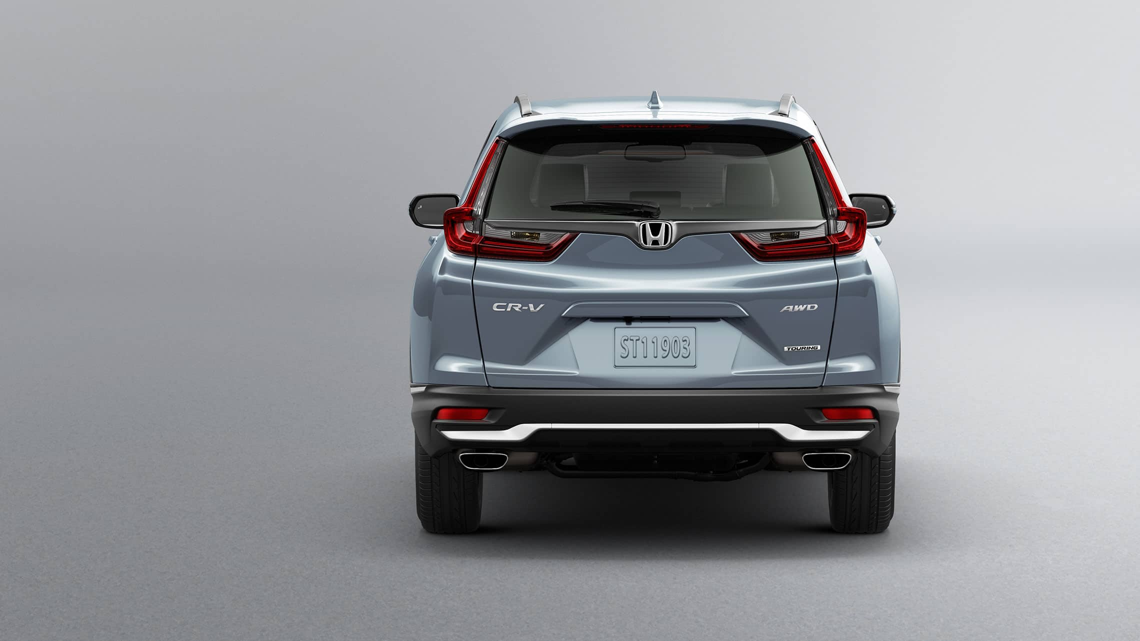 Rear view of 2021 Honda CR-V Touring in Sonic Gray Pearl showing dual chrome exhaust finishers.
