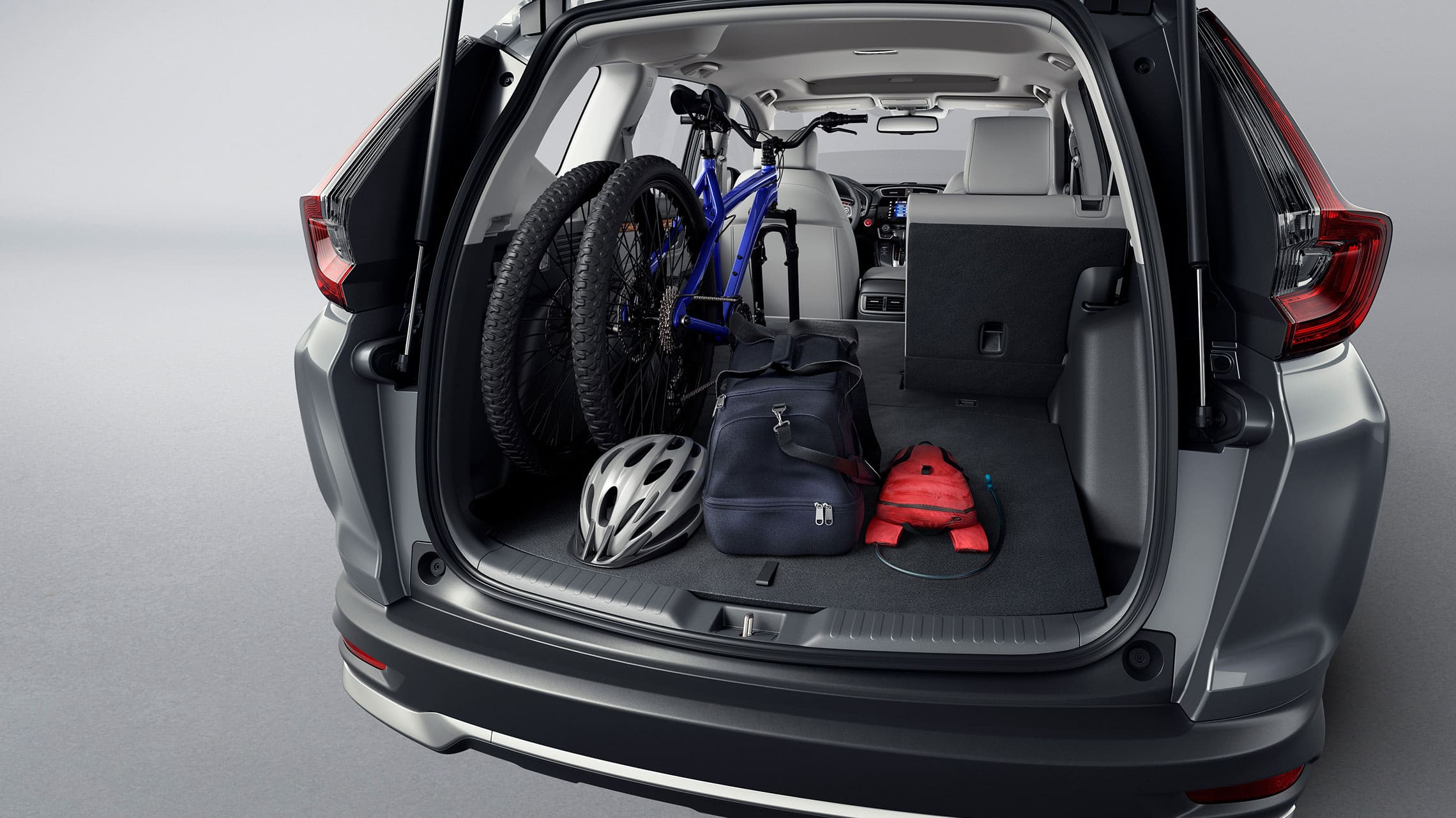 Rear view of 2021 Honda CR-V Touring in Modern Steel Metallic demonstrating cargo space.