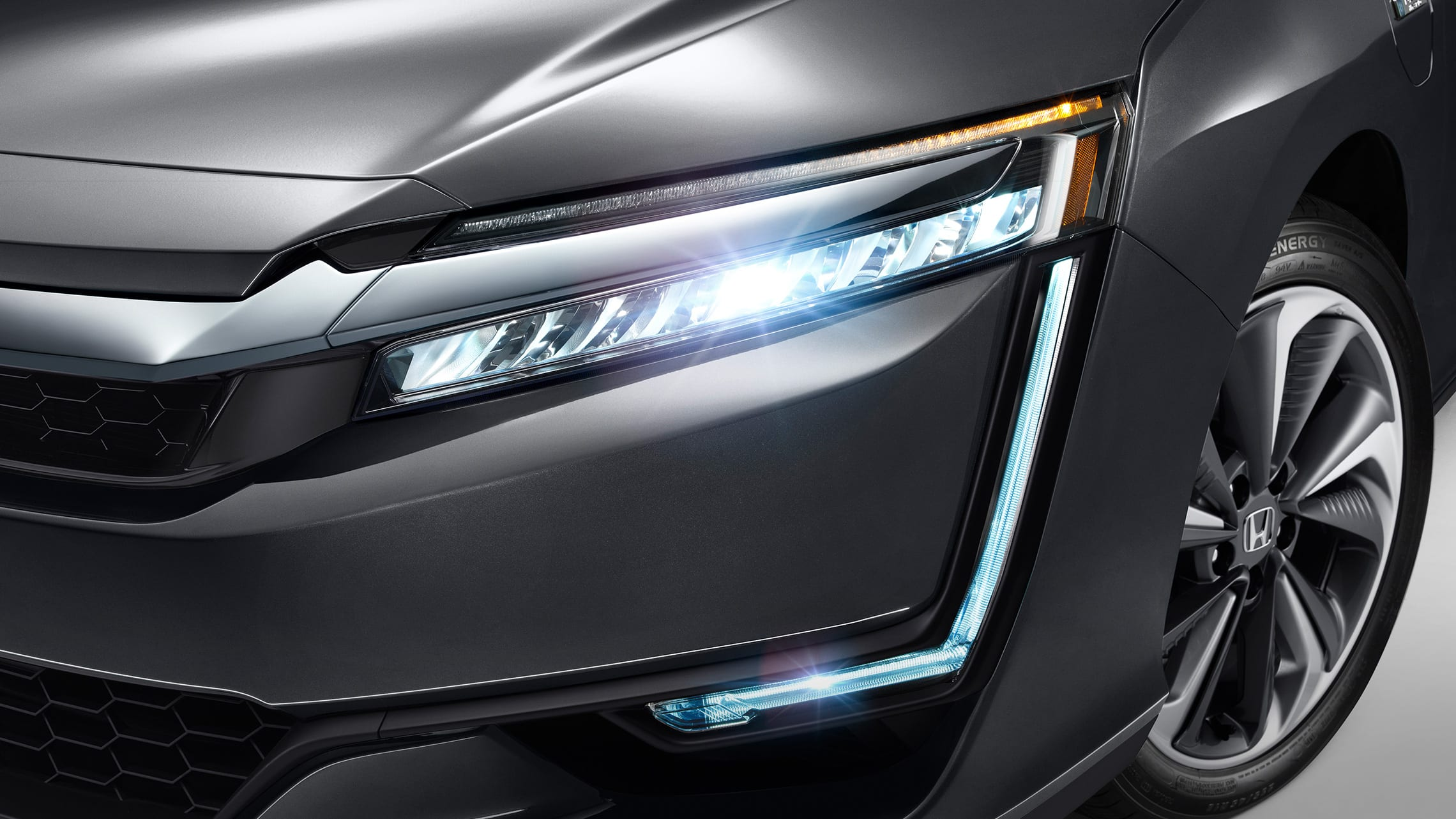Detail of full LED headlights and DRL on 2021 Clarity Plug-In Hybrid in Modern Steel Metallic.